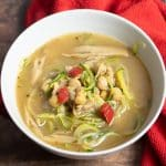 chickpea zucchini noodle soup in a white bowl