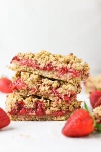 three strawberry oatmeal bars stacked on top of each other