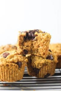 chocolate chip vegan pumpkin muffin bitten into