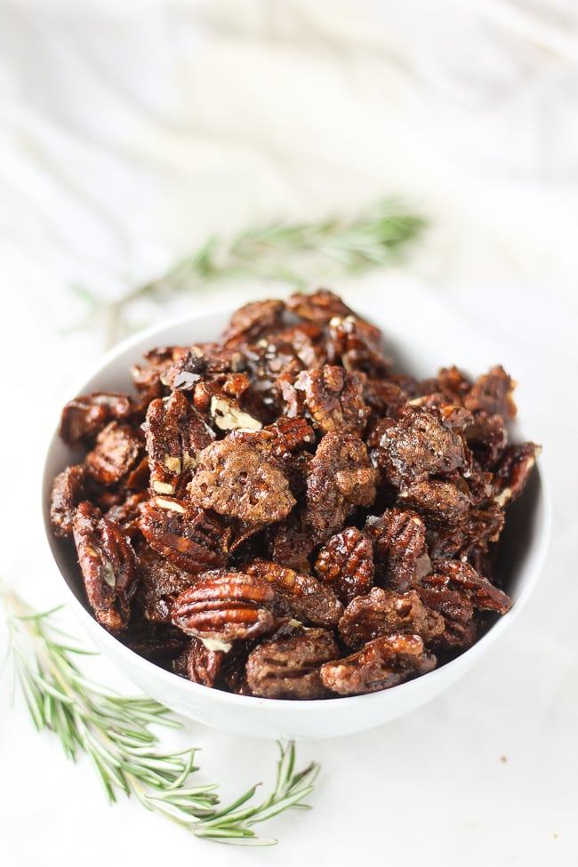 vegan candied pecans in a white bowl