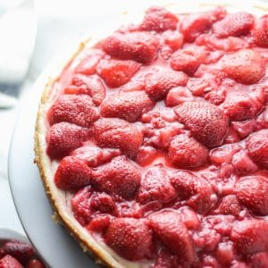Unsliced strawberry vegan cheesecake
