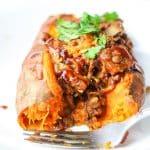 sweet potato cut open stuffed with lentils, mushrooms, jackfruit and BBQ sauce