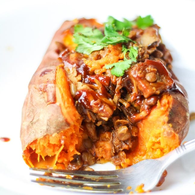 sweet potato cut open stuffed with lentils, mushrooms, jackfruit and BBQ sauce