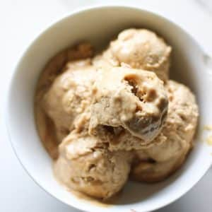 4 scoops of peanut butter ice cream in a white bowl