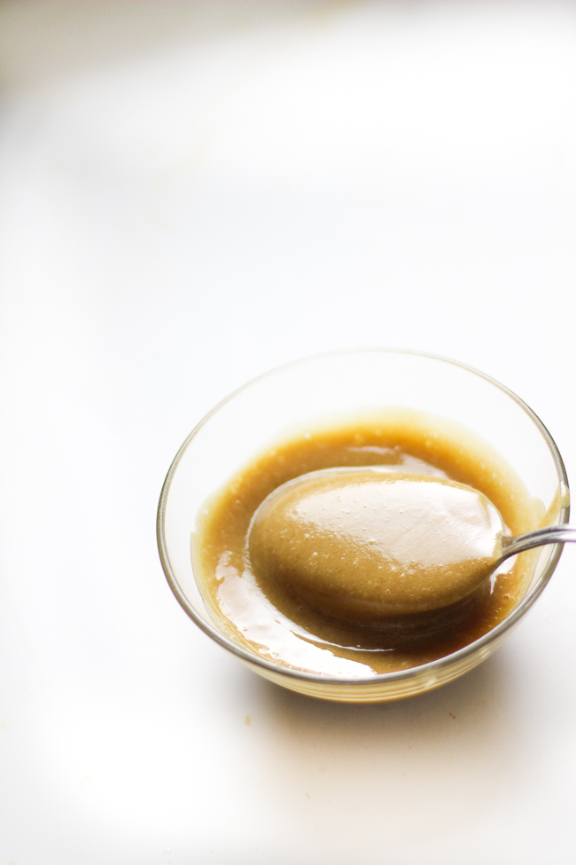 date caramel sauce on a bowl with a spoon