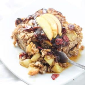 baked oatmeal topped with sliced apples with fork