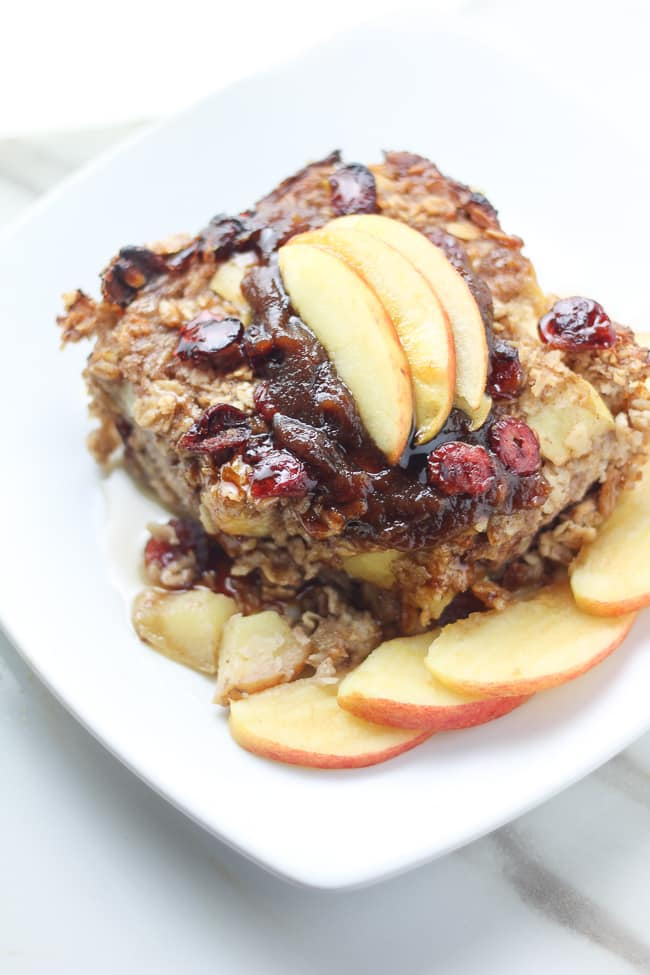 apple vegan baked oatmeal topped with apple slices