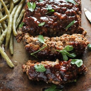 vegan meatloaf on a baking pan with green beans