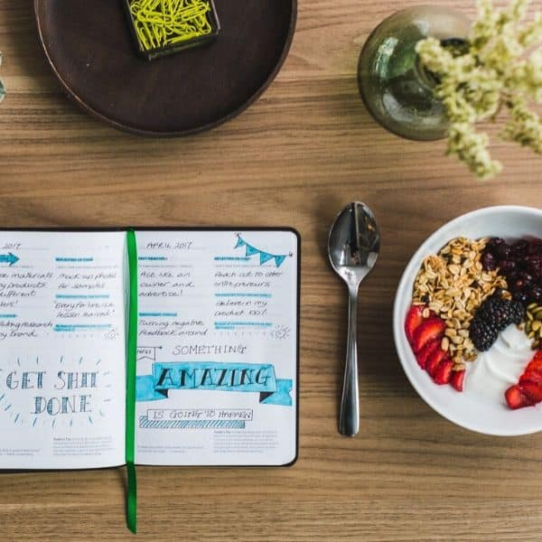 picture of food journal next to a plate of breakfast food