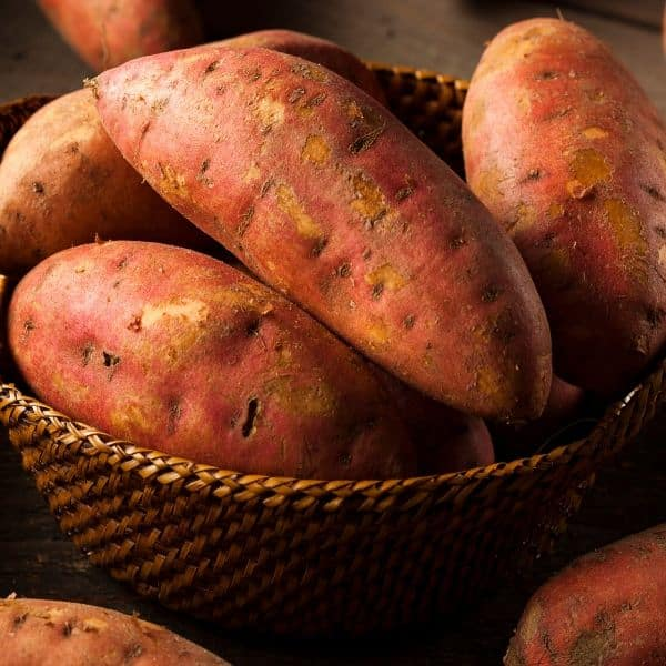 sweet potatoes in a basket to reference eating carbs