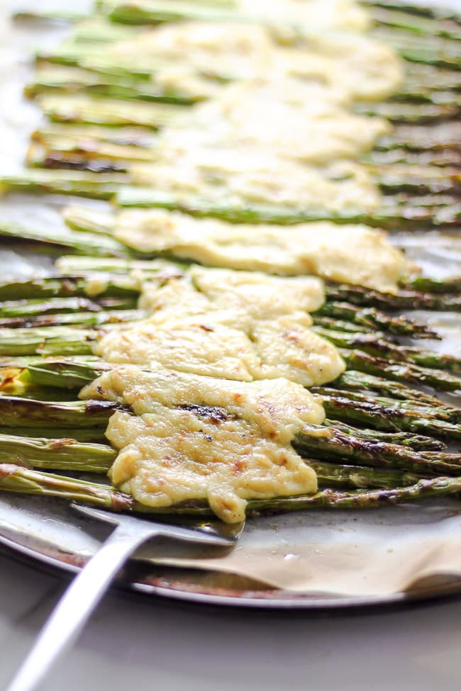 roasted asparagus with melted vegan cheese spatula