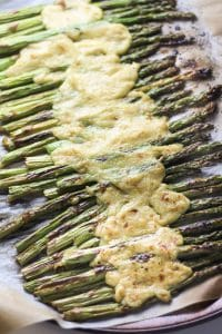 roasted asparagus with melted vegan cheese