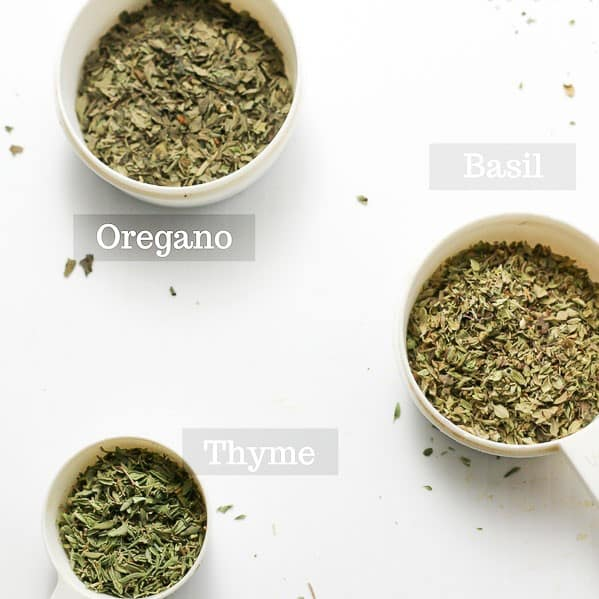 pictures of oregano, basil, and thyme in separate measuring cups