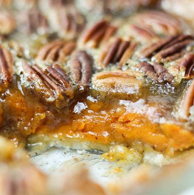 sweet potato pecan pie sliced through to show the both layers of the filling