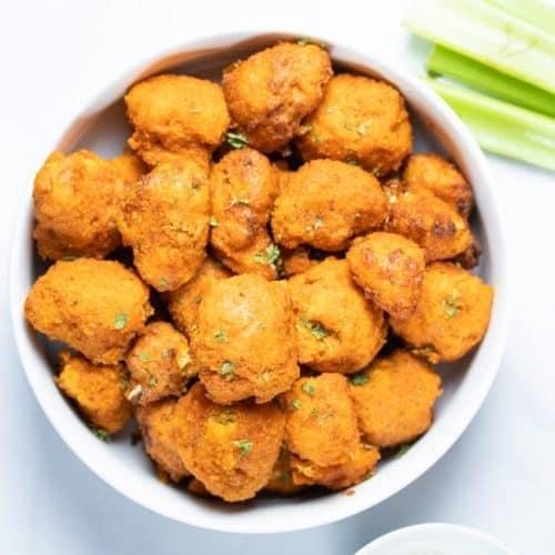 buffalo cauliflower bites in a white bowl