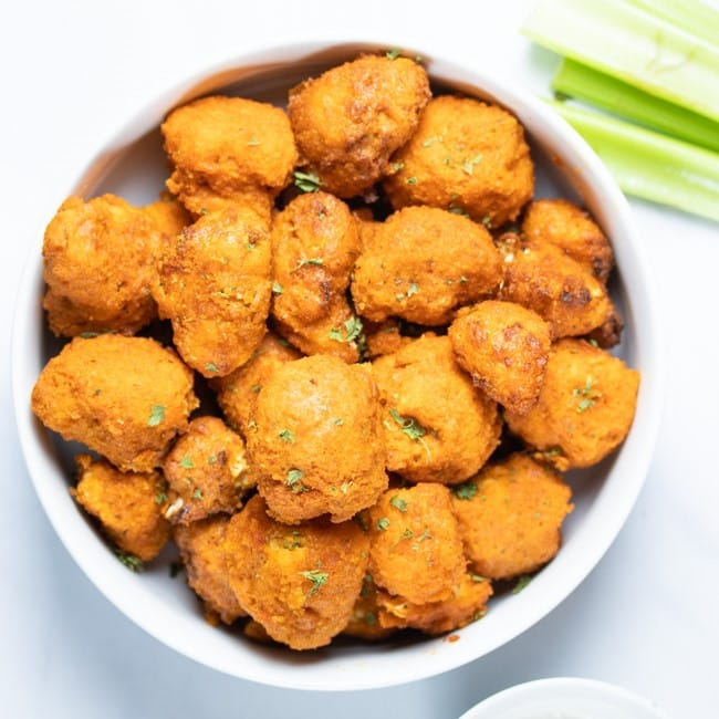 buffalo cauliflower bites in a white bowl