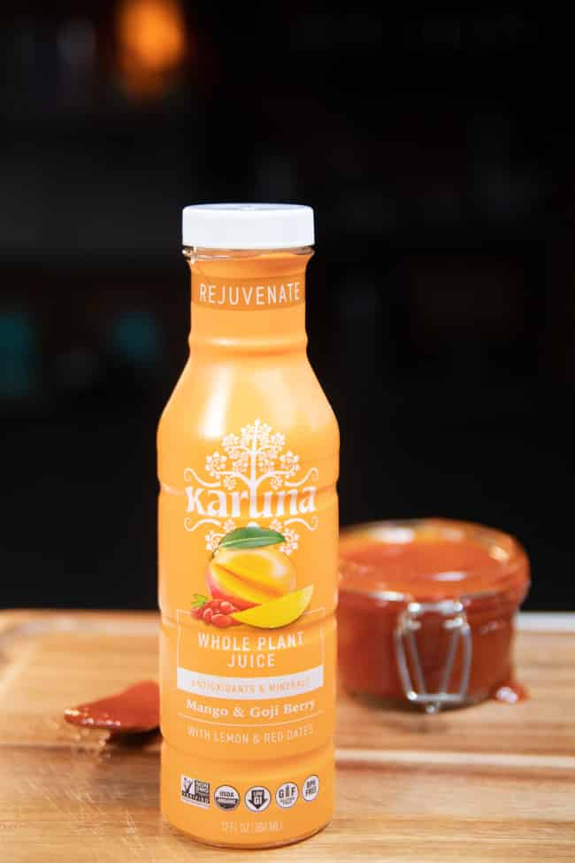 karuna mango juice next to bbq sauce