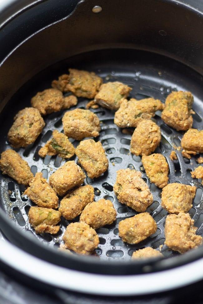 fried okra in an air fryer basket